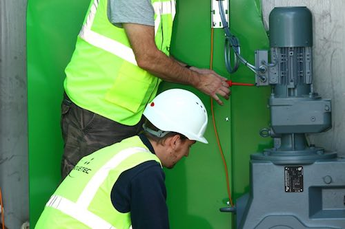 Advetec engineers installing XO system