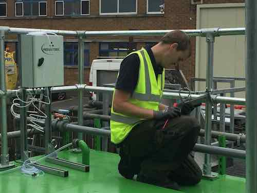 Engineer installing Bio-Reactor for wastewater treatment